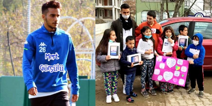 Bodrumsporlu genç futbolcu ilk sözleşme parası ile 15 köy öğrencisine tablet aldı